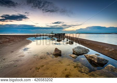 Beautiful sunset over the beach at Baltic Sea in Gdansk, Poland.