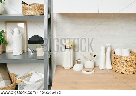 Set of natural items for bodycare and hygiene on table and shelves