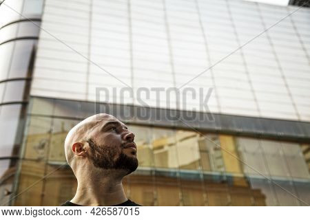 Ambitious Serious Young Businessman Looking Into The Future Concept. Bearded Caucasian Man Against A