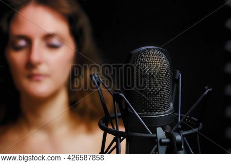 Problems For Vocalists And Singers When Recording Songs In A Studio. Young Woman Blur Next To Microp