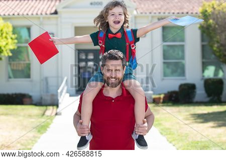 Amazed Father And Son Run With Father After Come Back From School. School, Family, Education And Out