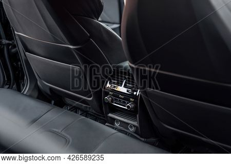 Interior Of A Premium Car. The Back Seat Of Prestige Luxury Modern Car. Black Leather And Rear Seat