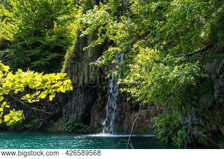 Majestic View On Waterfall With Turquoise Water In The Plitvice Lakes National Park, Croatia. Europe