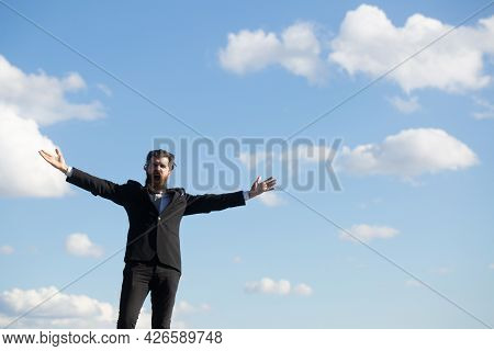 Man In Suit Raising Hand On Sky Background. Freedom Adventure And Business Victory Concept. Success