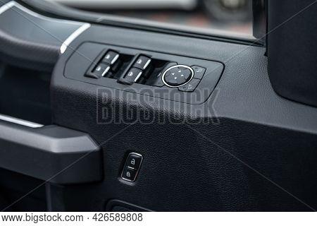 Mirror Control Knob And Window Control Panel In A Modern Car. Automatic Car Window Controls And Deta