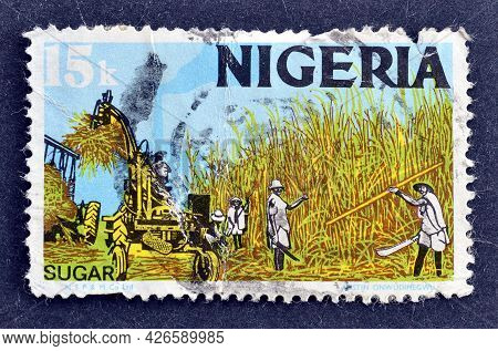 Nigeria - Circa 1973 : Cancelled Postage Stamp Printed By Nigeria, That Shows Sugar Harvest Producti