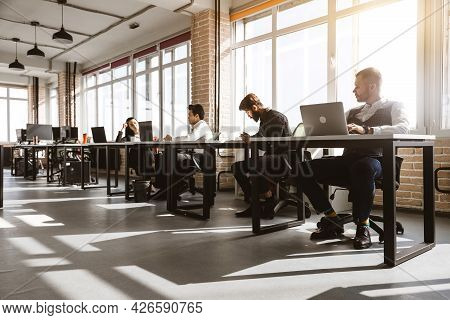 Group Of Young Business People In Smart Casual Wear Working Together In Office. Team At Work.
