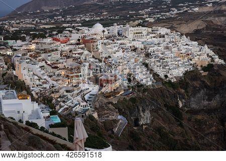 Illuminated Balcony Decks And Patios With Restaurants Of Fira Town On Santorini Island. Cyclades, Gr