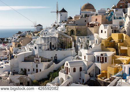 Oia, Santorini, Greece - June 28, 2021: Whitewashed Houses And Windmills In Oia On Santorini Island,