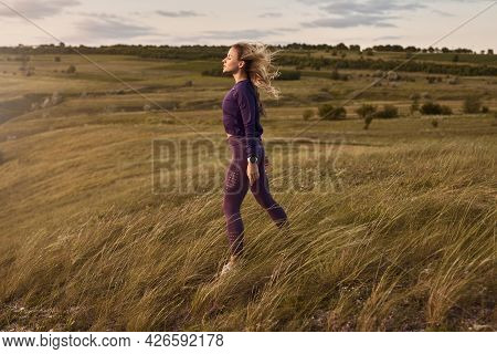 Side View Of Young Female In Sportswear Enjoying Fresh Wind While Having Break During Outdoor Fitnes