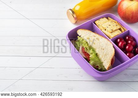 Delicious Healthy Sandwich In A Lunch Box, Cookies And Cherries. Take Lunch With You To School Or Th