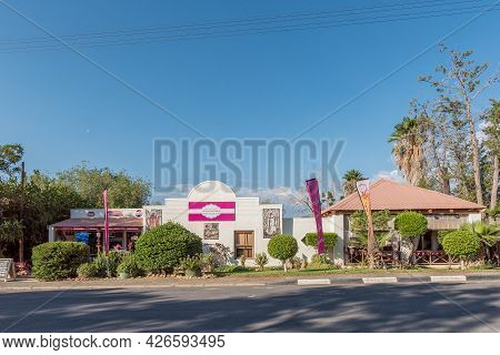 Prince Albert, South Africa - April 20, 2021: A Street Scene, With The La-di-dah Restaurant And Coff