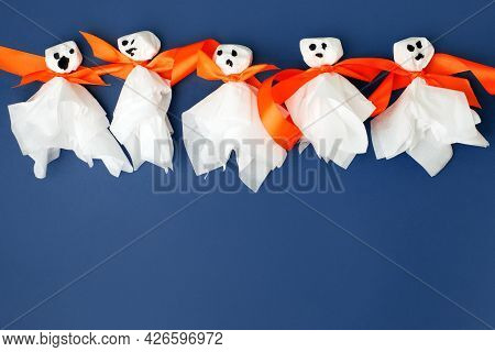 Set Of Materials For Halloween Toys Ghost From White Paper Napkin. Creative Diy For Kids On Blue. Ho