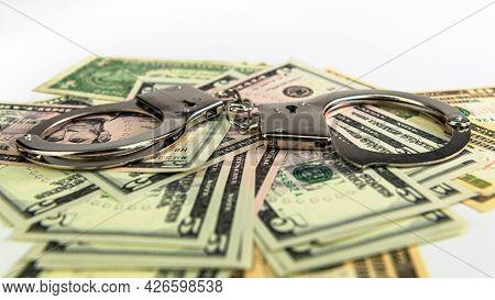 Handcuffs On Money Background, Dollar Bills, Money Cash Corruption, Dirty Money Financial Crime And