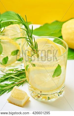 Summer Alcoholic Cocktail. Refreshment Lemon Soda Drink. Gin And Tonic With Lemon And Rosemary On Ta