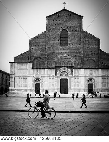 Bologna,  Italy - October 12, 2016: Cyclist by Basilica of San Petronio on Piazza Maggiore in Bologna city. Cityscape, black and white urban photography