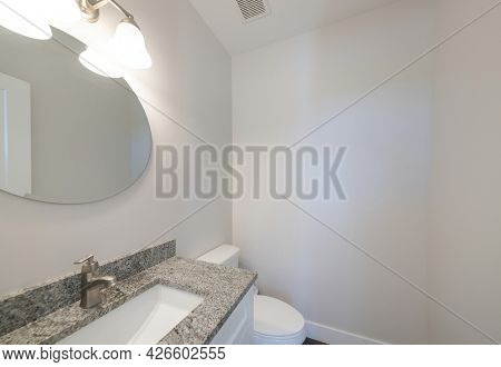 White Powder Room With Vanity Sink And Ceiling Vent