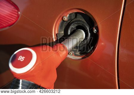 Refueling A Car At A Gas Station In The City