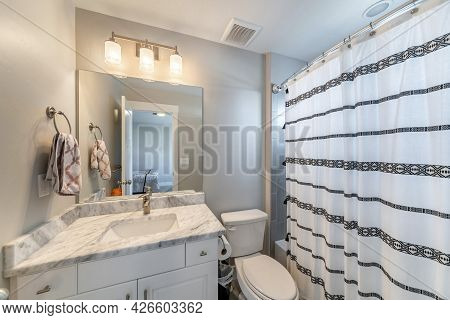 Small Bathroom Inside A Room With Ambient Lightnings And Bathtub