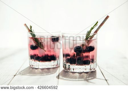 Two Glasses Of Drinks With Blueberries And Rosemary Sprigs. Summer Cocktails And Fresh Drinks Concep