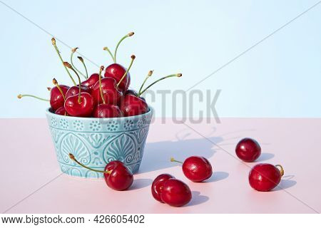 Fresh And Juicy Cherries In A Ceramic Bowl On A Pastel Pink Background. Copy Space. Seasonal Summer