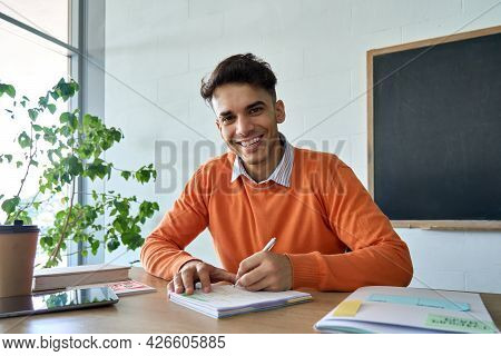 Young Happy Hispanic Indian Latin Student Gen Z Hipster Having Virtual Distant Class Course With Tea