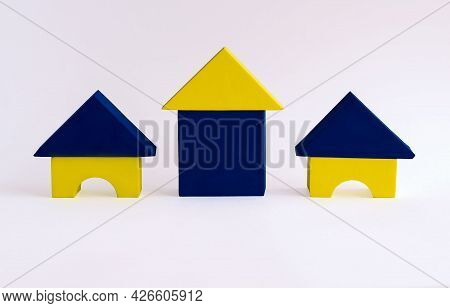 Colored Houses Made Of Children's Soft Designer On A White Background. Houses Made Of Geometric Shap