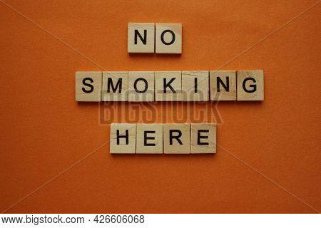 The Words No Smoking Here On The Background. Words Made Of Wooden Cubes. Smoking Is Prohibited, Proh
