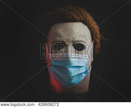 JUNE 12 2021:  Halloween slasher Michael Myers mask with a surgical mask, Covid 19 concept
