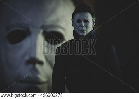 JUNE 12 2021:  Halloween slasher Michael Myers - Trick or Treat Studios action figure with mask in background