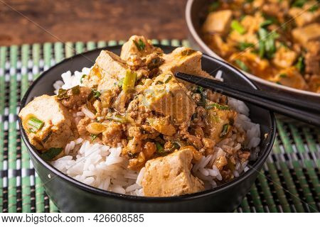 Mapo Tofu In A Bowl Of Rice Close-up With Chopsticks