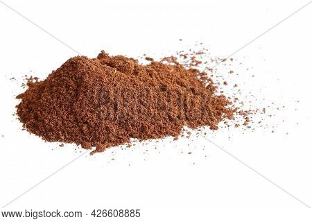 A Slide Of Ground Coffee On A Light Background. A Pile Of Ground Coffee Is Poured.