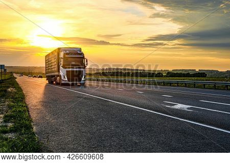 Moscow region, Russia - July, 4, 2021: Truck on a speedway at sunset in Moscow region, Russia