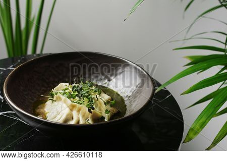 Dim Sum In Ceramic Plate Closeup On Marble Table. Dim Sum Chinese Traditional Food Served With Micro