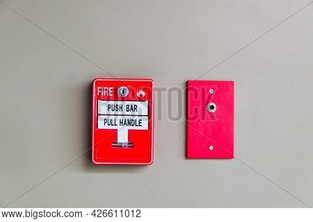 Fire Alarm Press Machine And Firefighter Phone Jack That Installed On Concrete Wall Of Building, Ala