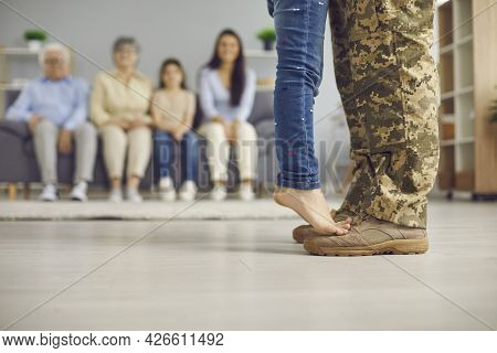 Copy Space Background With Childs And Veteran Dads Feet On Day Of His Returning Home