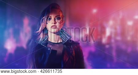 A beautiful cyberpunk girl stands against the backdrop of the night city of the future. Cyberpunk concept. Technology and fashion.