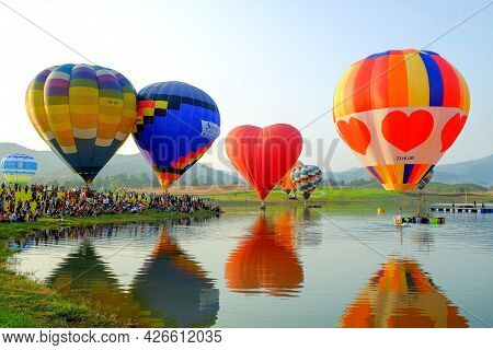 Chiang Rai-thailand Feb 16 2017: People And Tourists Are Watching Hot-air Balloon Show At The Singha