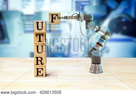 Future, Industrial Gripping Robot Picking Wooden Letter For Build Message On Wooden Desk And Machine