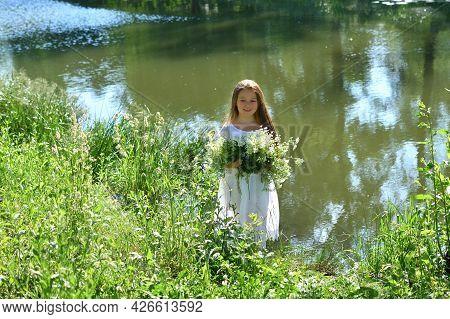 Girl In Beautiful Wreath On Summer Meadow Near The River. Feast Of Ivan Kupala.midsummer. Earth Day.