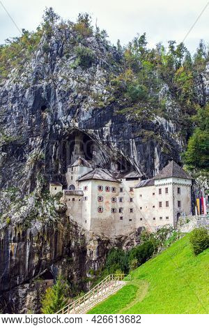 Old medieval castle in the park. Magical places in Slovenia. Postojna Cave. Limestone plateau. The famous and most visited place in the country by tourists.