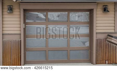 Pano Glass Paned Garage Door Of Home In The Mountain Blanketed With Snow In Winter