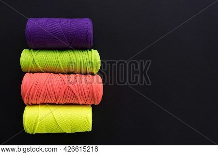 Skeins Of Cotton Yarns For Macrame Knitting On Dark Backdrop