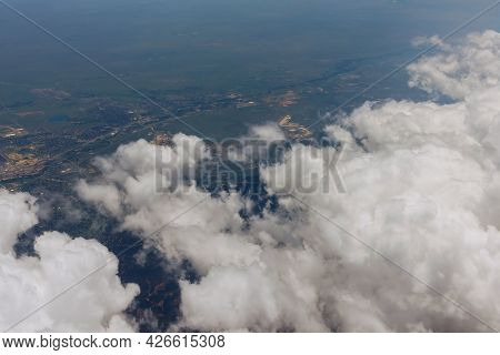 View From The Plane Window Overlooking The Clouds The Structure Of Denver City In America