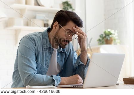 Man Looks At Laptop Screen Feels Confused Experiencing Problems
