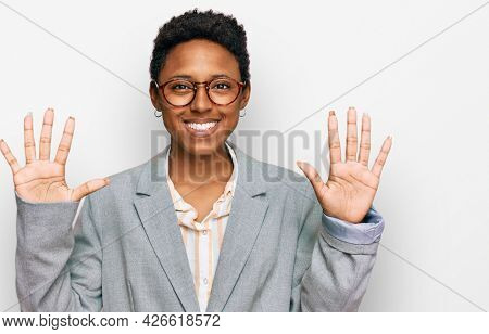 Young african american woman wearing business clothes showing and pointing up with fingers number ten while smiling confident and happy.