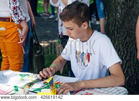 Zaporizhia, Ukraine- June 19, 2021: Charity Family Festival:  Boy Participating At Art And Craft Out