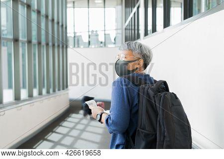 Behind Asian Senior Smart Woman Traveler Hipster Wear Medical Facemask Prevent Covid-19 Virus Diseas