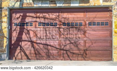 Pano Paneled Garage Door With Glass Panes Of A Park City Home On A Sunny Winter Day