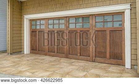 Pano Glass Paned Wooden Door Of An Attached Garage Of House In Long Beach California